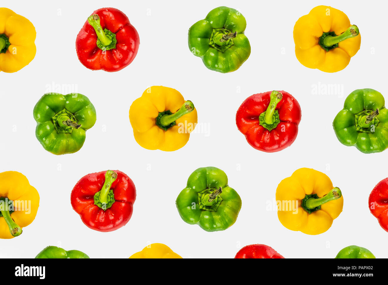 Top view pattern of fresh bright bell peppers on white background. Shot from above of multiple colorful paprika vegetables - Stock Image