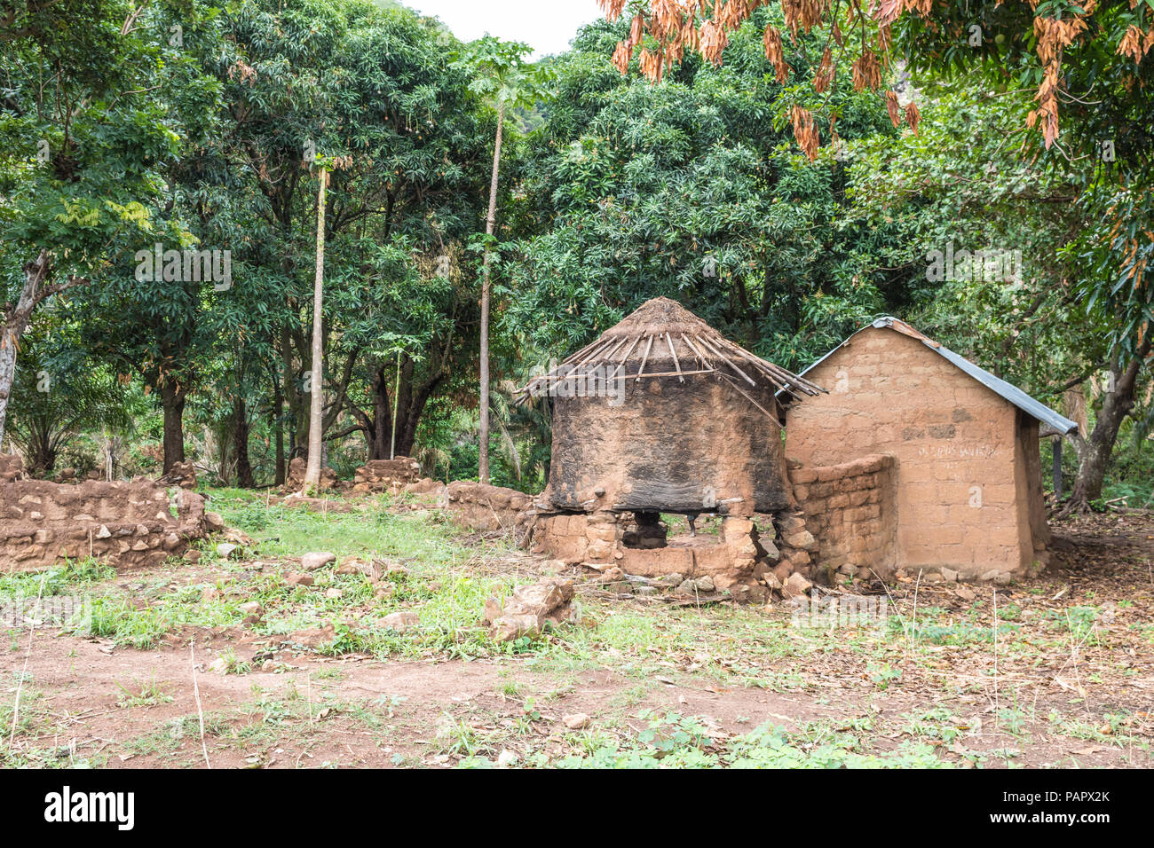 A beautiful picturesque view of a mountain side dwelling with trees, rocks and huts. It is beside a hiking trail. This was a grueling hike but awesome - Stock Image
