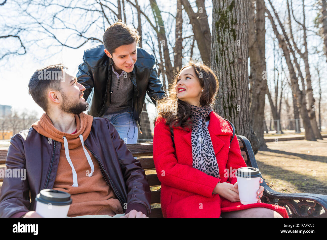 Russia, Moscow, group of friends at park, having fun together, drinking coffee - Stock Image