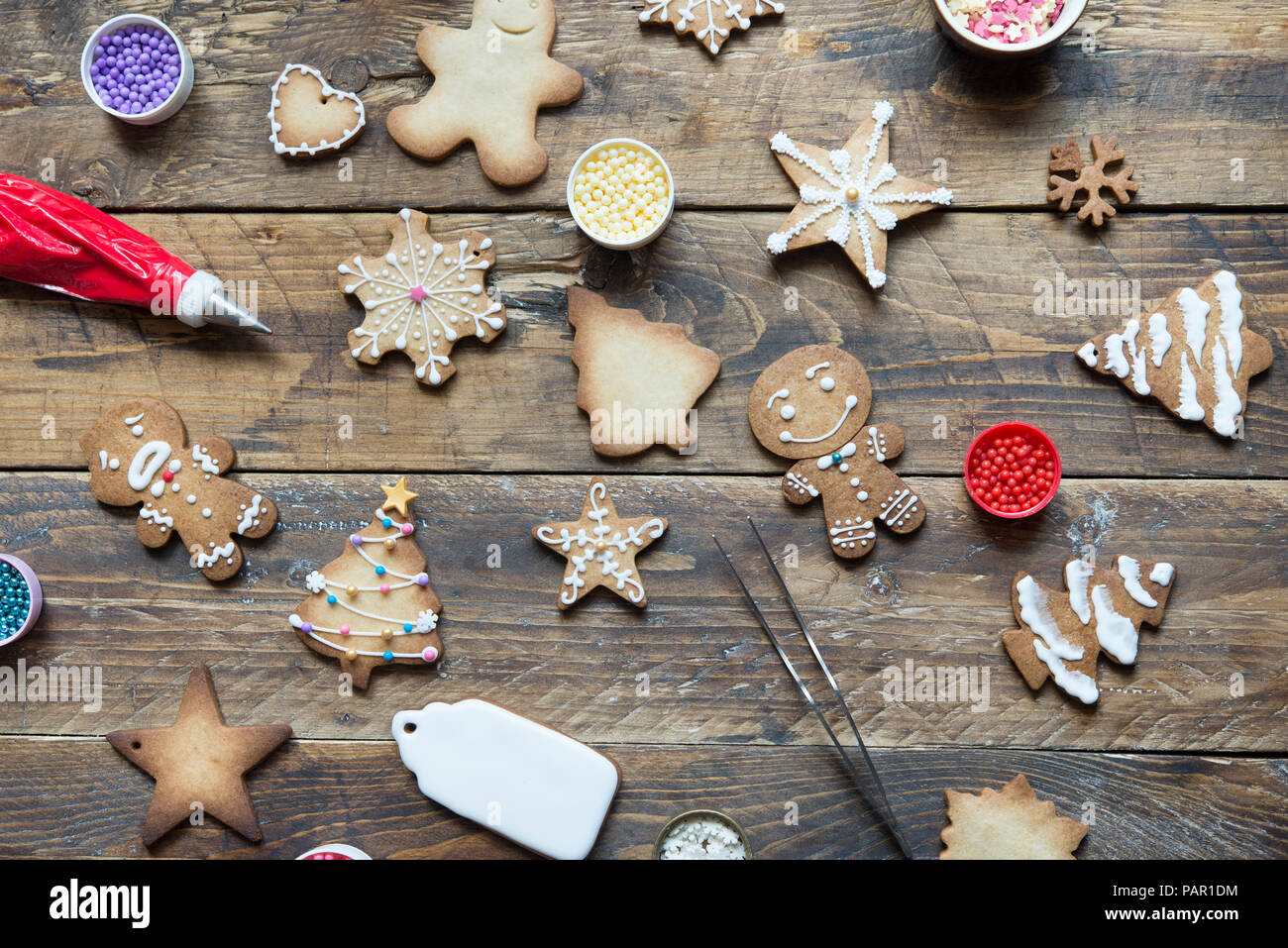 Various Gingerbread Cookies on wood - Stock Image