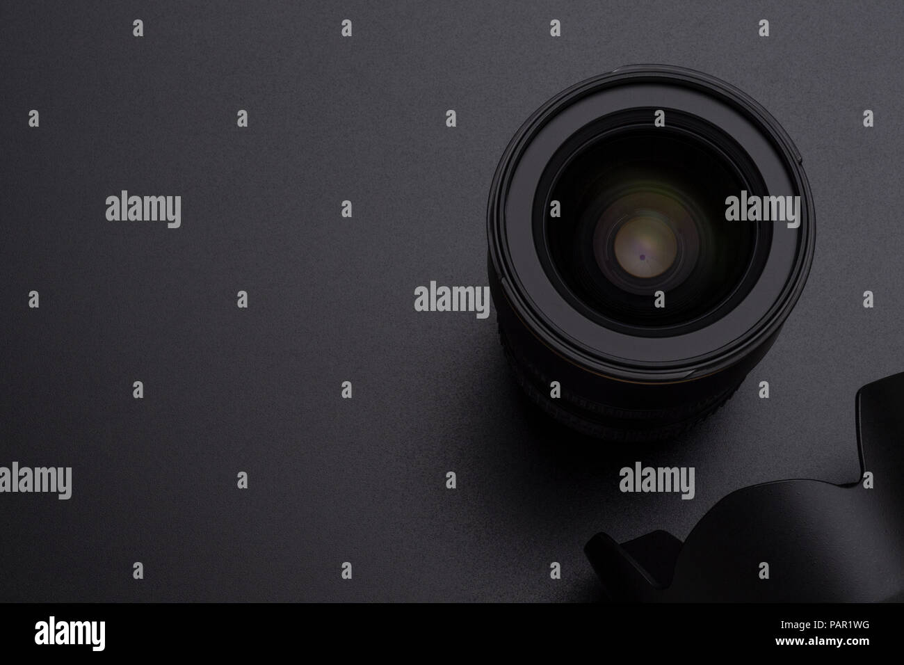 Photo DSLR camera or video lens and hood close-up image on black background - Stock Image