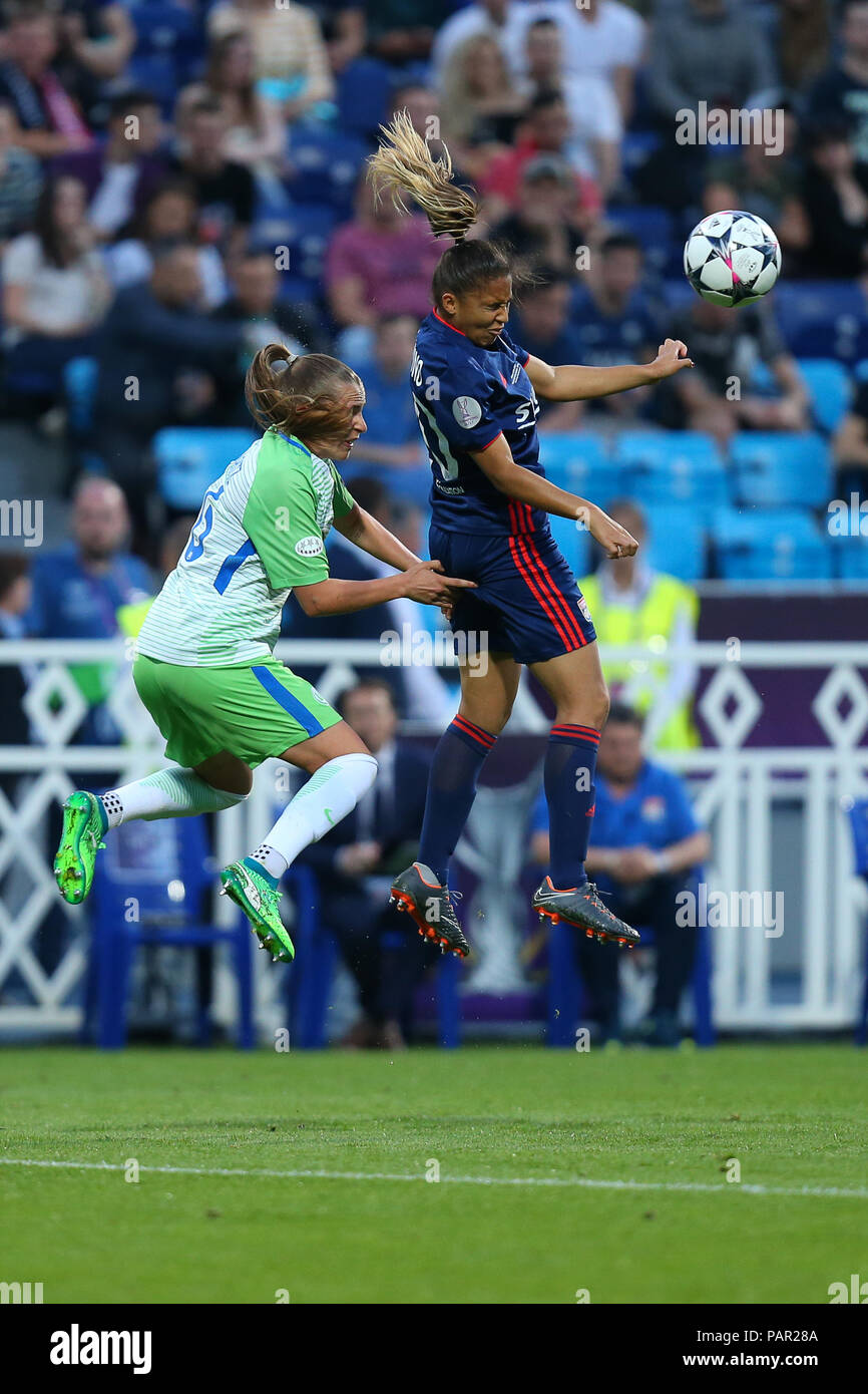 KYIV, UKRAINE - MAY 24, 2018: Delphine Cascarino with impressive beautiful header challenging the ball in air. UEFA Women's Champions League final Wol - Stock Image