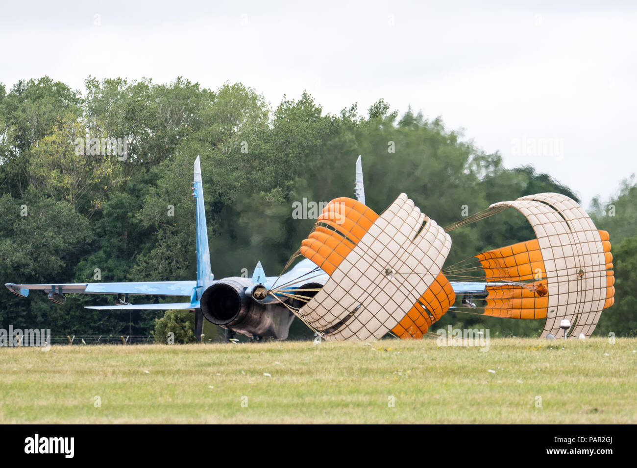 RAF FAIRFORD, GLOUCESTERSHIRE, UK JULY 2017: A Ukranian Air Force Sukhoi SU-27 Flanker deploys it's landing chutes as it lands at RAF Fairford during - Stock Image