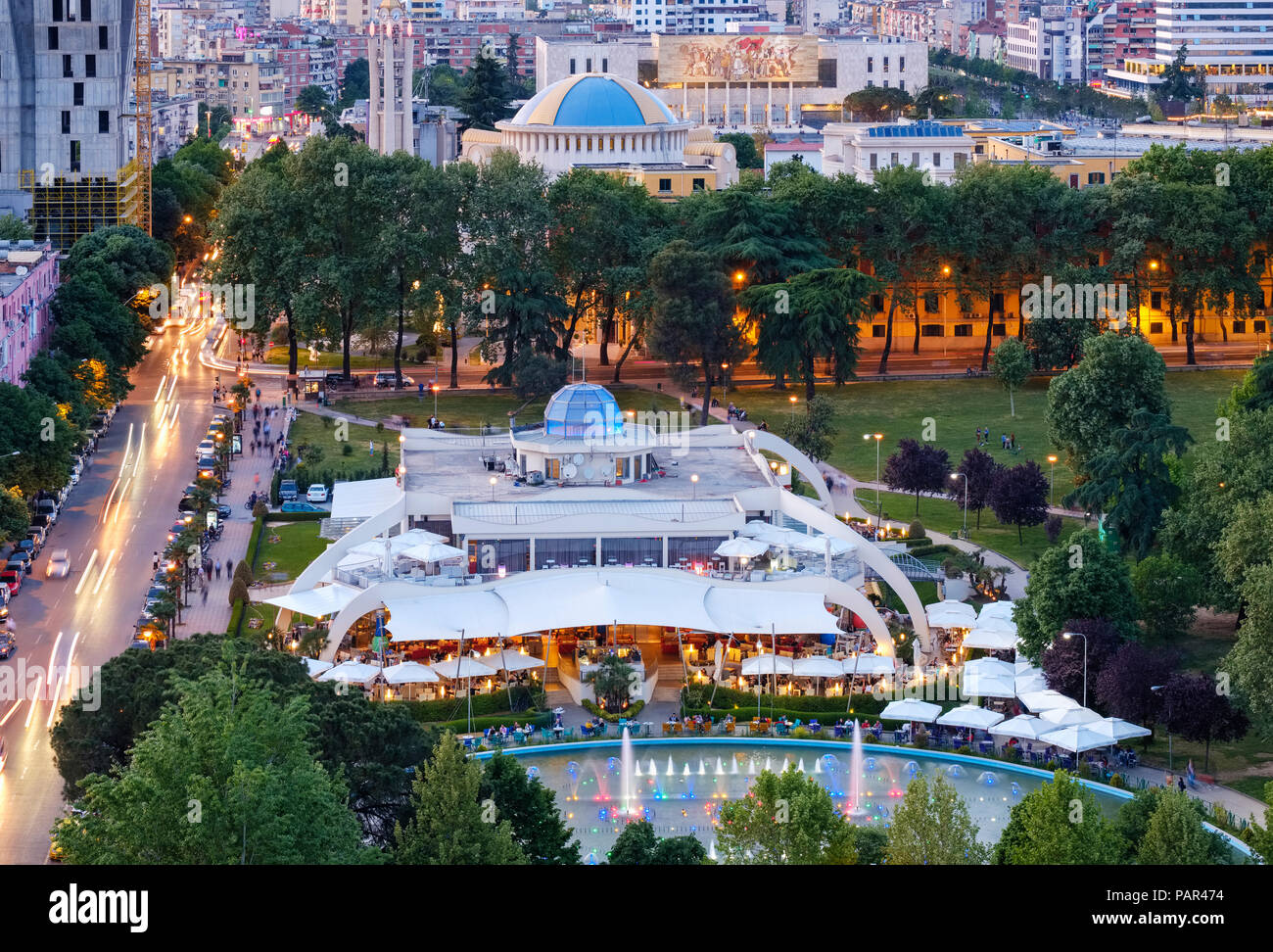 Albania, Tirana, Cafe Taiwan in Rinia Park, resurrection cathedral in the background - Stock Image