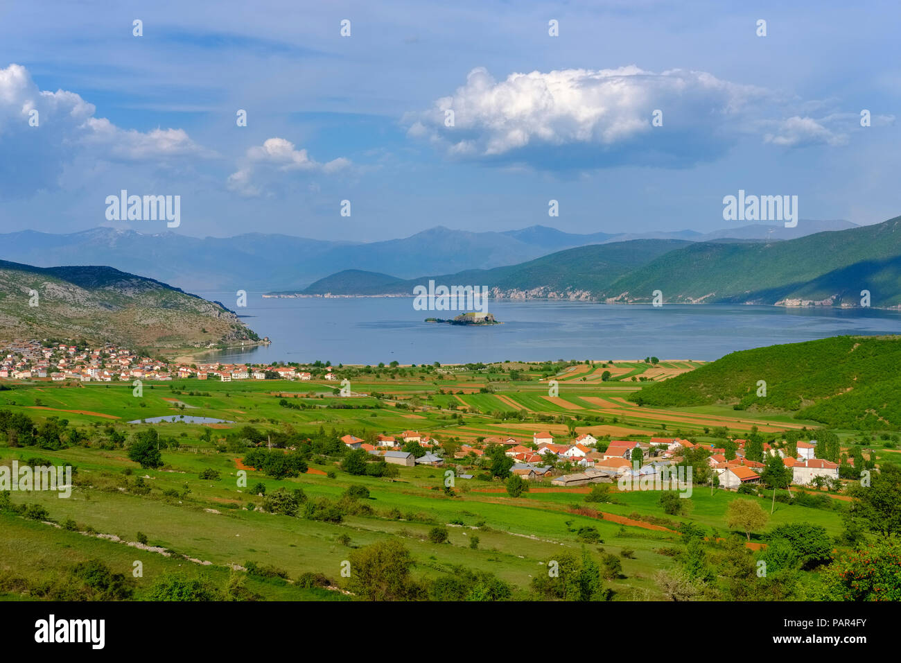 Albania, Prespa National Park, Lake Prespa with Maligrad Island and villages Lejthize and Liqenas, Greece and Macedonia in the background - Stock Image