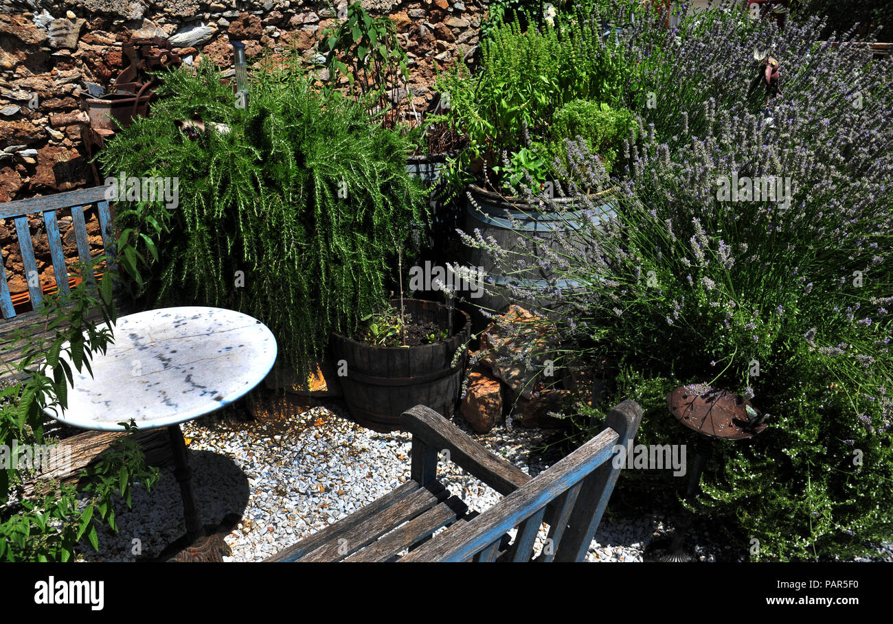 Secret Garden seating area in a wonderful courtyard garden in the South of France. Property released - Stock Image