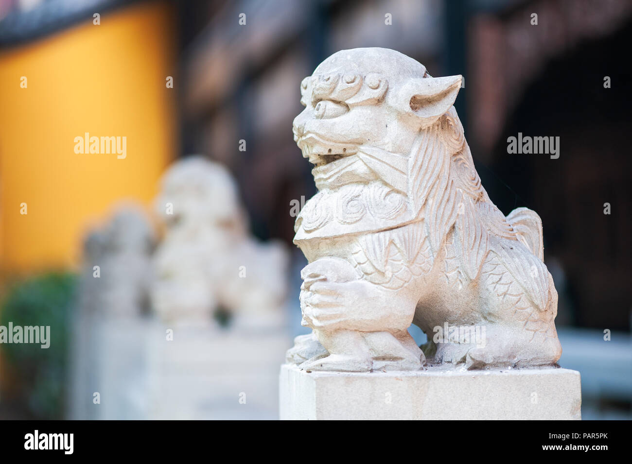 Lion white stone statue in a buddhist temple, Chongqing, China - Stock Image