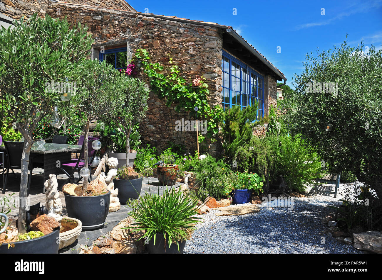 Wonderful courtyard garden in the South of France. Property released - Stock Image