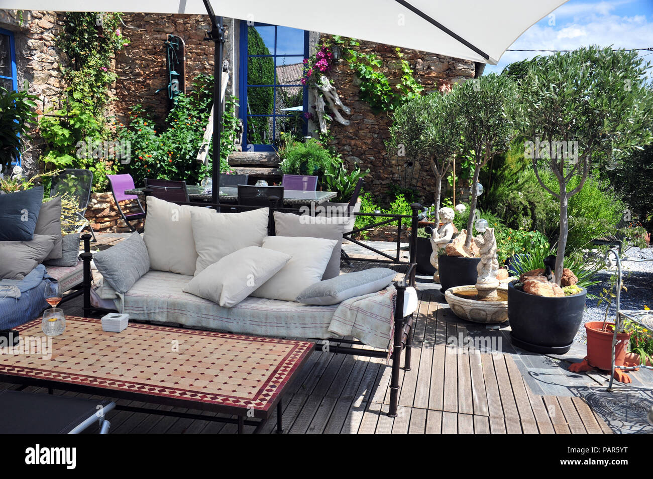 Garden seating area in a wonderful courtyard garden in the South of France. Property released - Stock Image