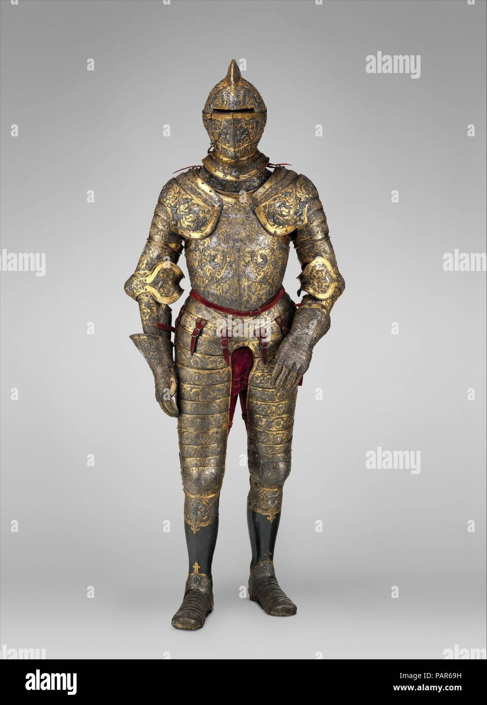 Armor of Henry II, King of France (reigned 1547-59). Culture: French, possibly Paris. Designer: Part of the decoration design by Jean Cousin the Elder (French, Souci (?) ca. 1490-ca. 1560 Paris (?)); Part of the decoration design possibly by Baptiste Pellerin (French, documented in Étampes 1542-75 Paris). Dimensions: H. 74 in. (187.96 cm); Wt. 53 lb. 4 oz. (24.20 kg). Date: ca. 1555.  This is one of the most elaborate and complete French parade armors, and it retains much of its original coloring. The surfaces are covered by dense foliate scrolls inhabited by human figures and a variety of fab - Stock Image