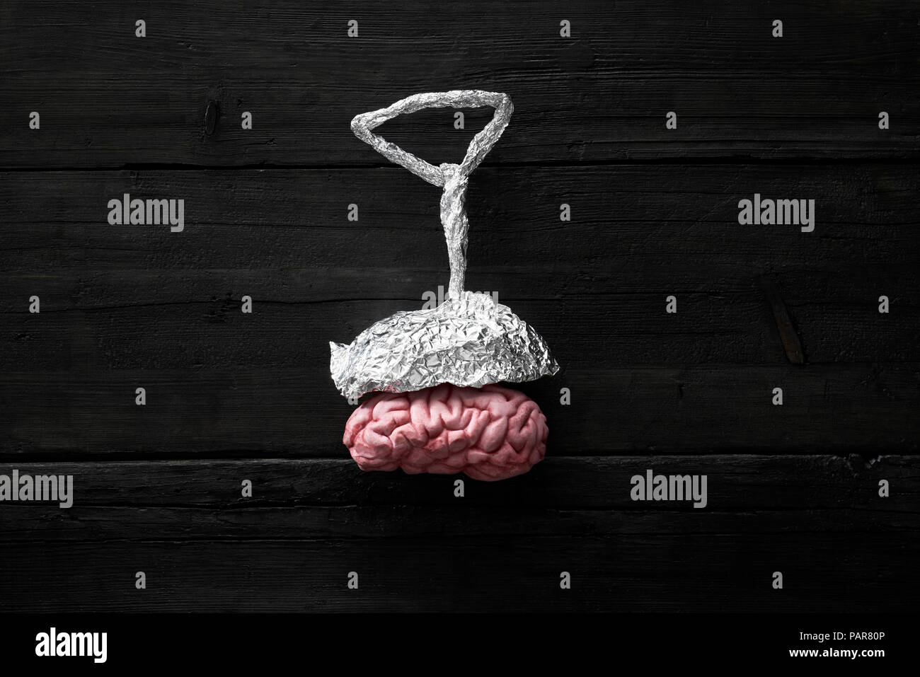 Aluminium bonnet on a brain, brain wash and conspiracy theories - Stock Image