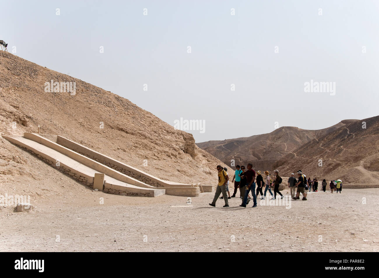 Tourists visit the tombs of ancient Egyptian pharaohs in Egypt's Valley of the Kings, at Luxor, Egypt. - Stock Image