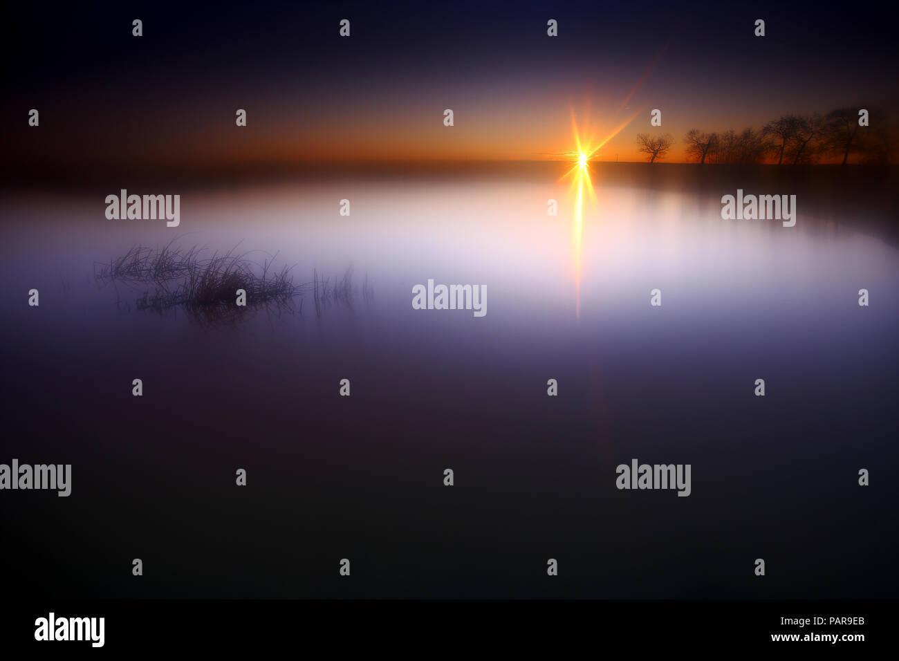 Spain, Castilla y Leon, Province of Zamora, Reserva natural de Lagunas de Villafafila, lake at sunset - Stock Image