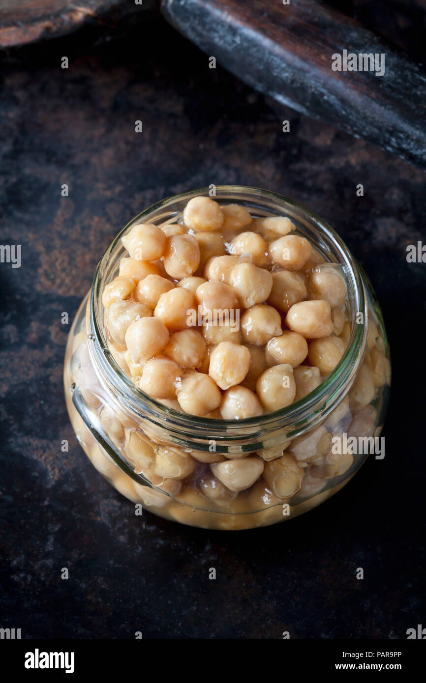 Glass of preserved chickpeas - Stock Image