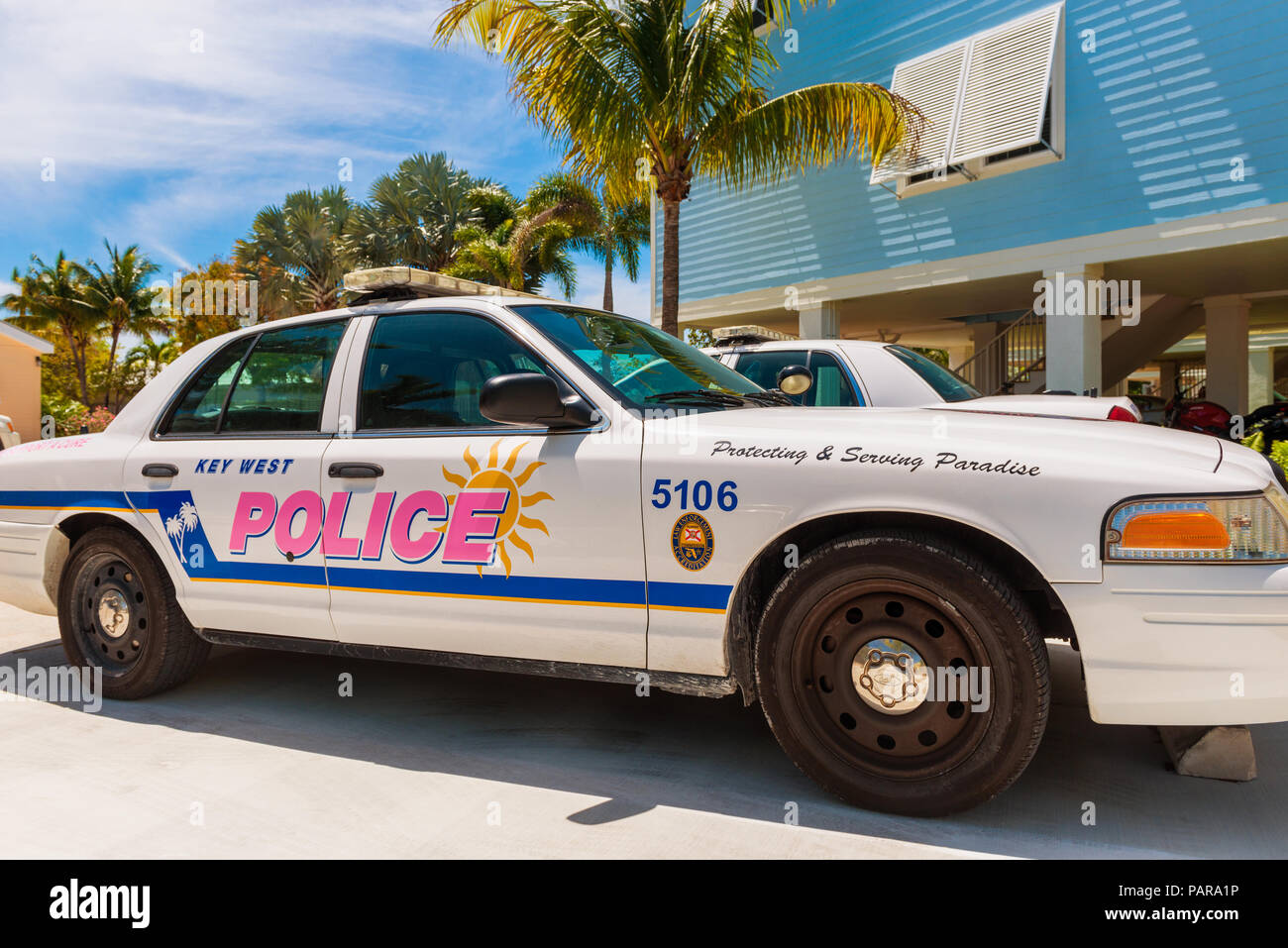 """Key West Police Car in Little Torch Key, Florida Keys, Florida, USA, The tagline on the car says """"Protecting & Serving Paradise."""" Stock Photo"""
