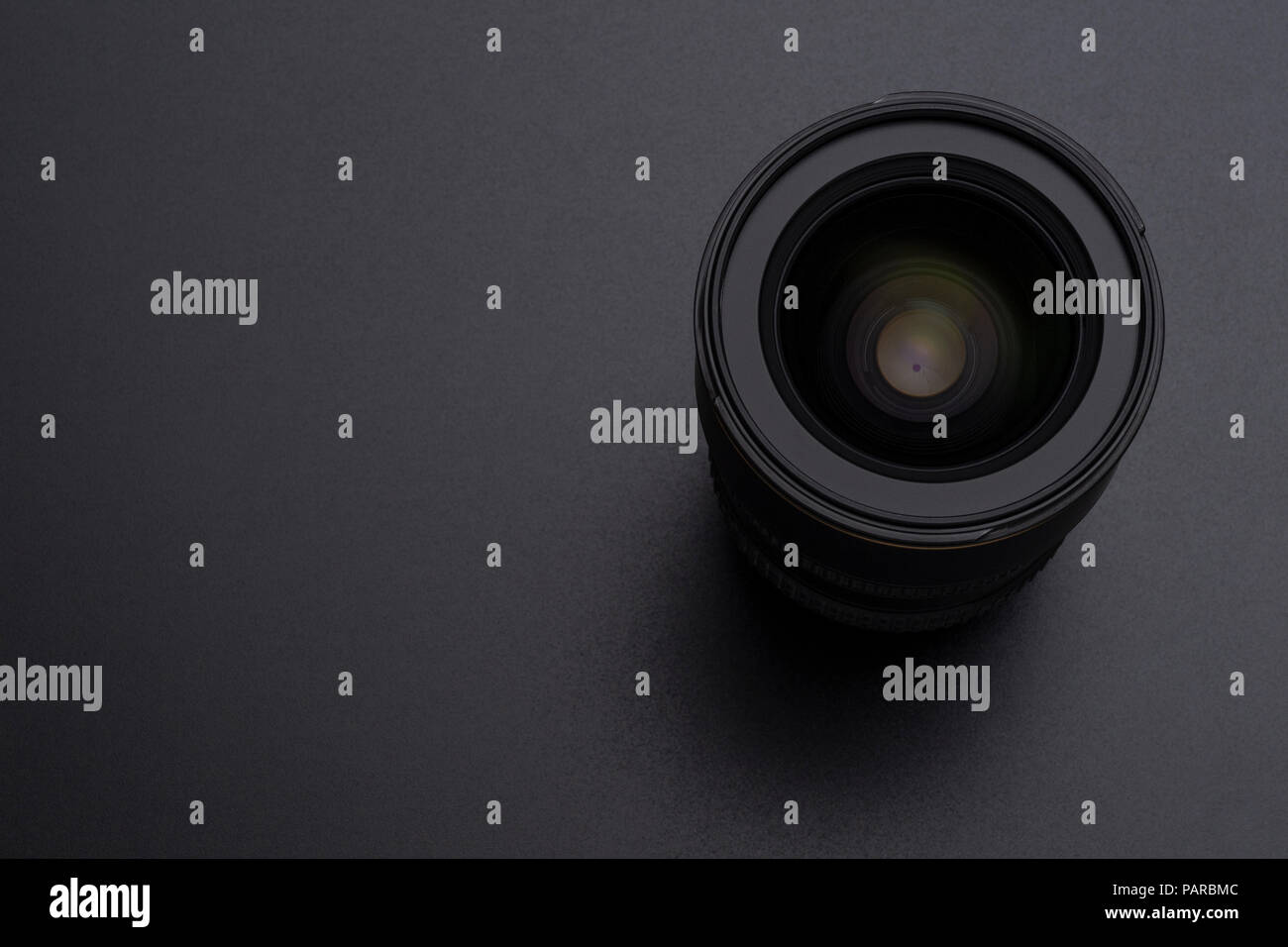 Photo DSLR camera or video lens close-up image on black background - Stock Image