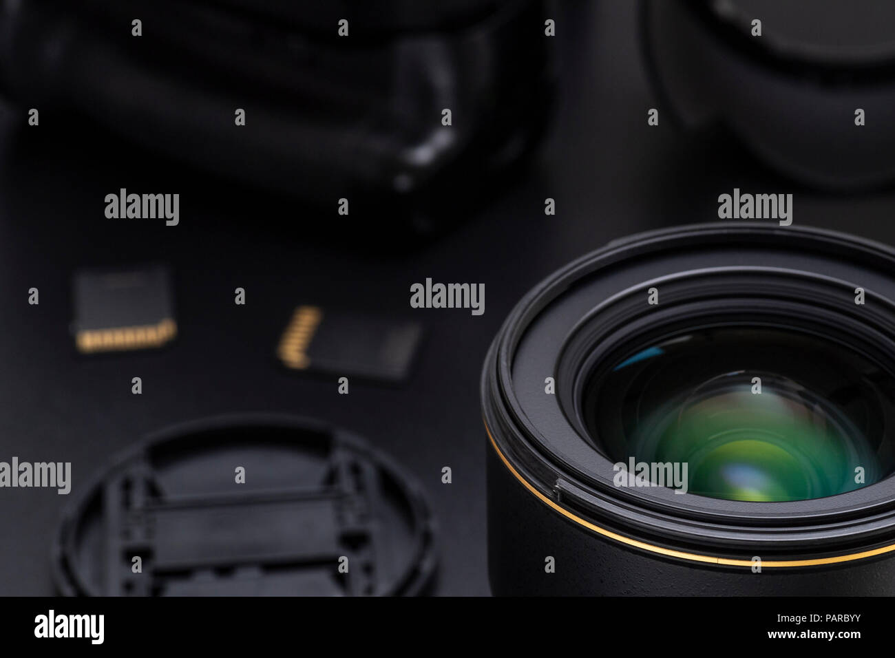 Photo DSLR camera or video lens close-up image with photography equipment on black background - Stock Image