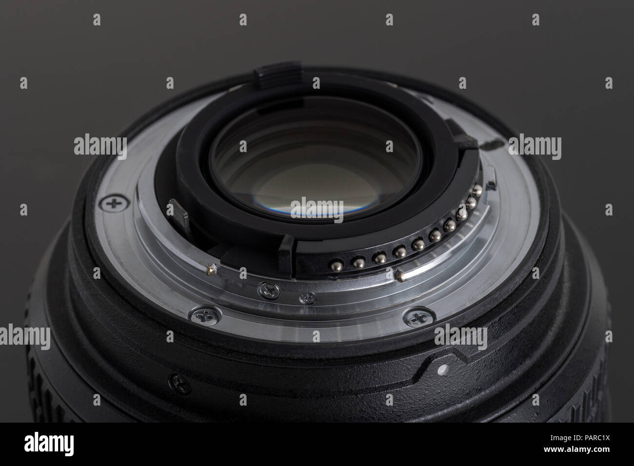 Close up detail rear element view of photo DSLR camera or video lens on black background - Stock Image