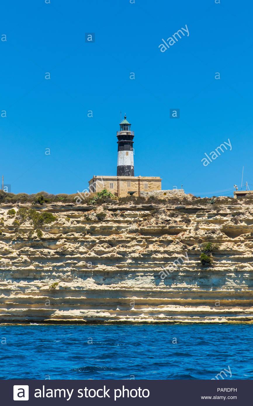 delimara lighthouse at delimara peninsula near marsaxlokk, malta - Stock Image