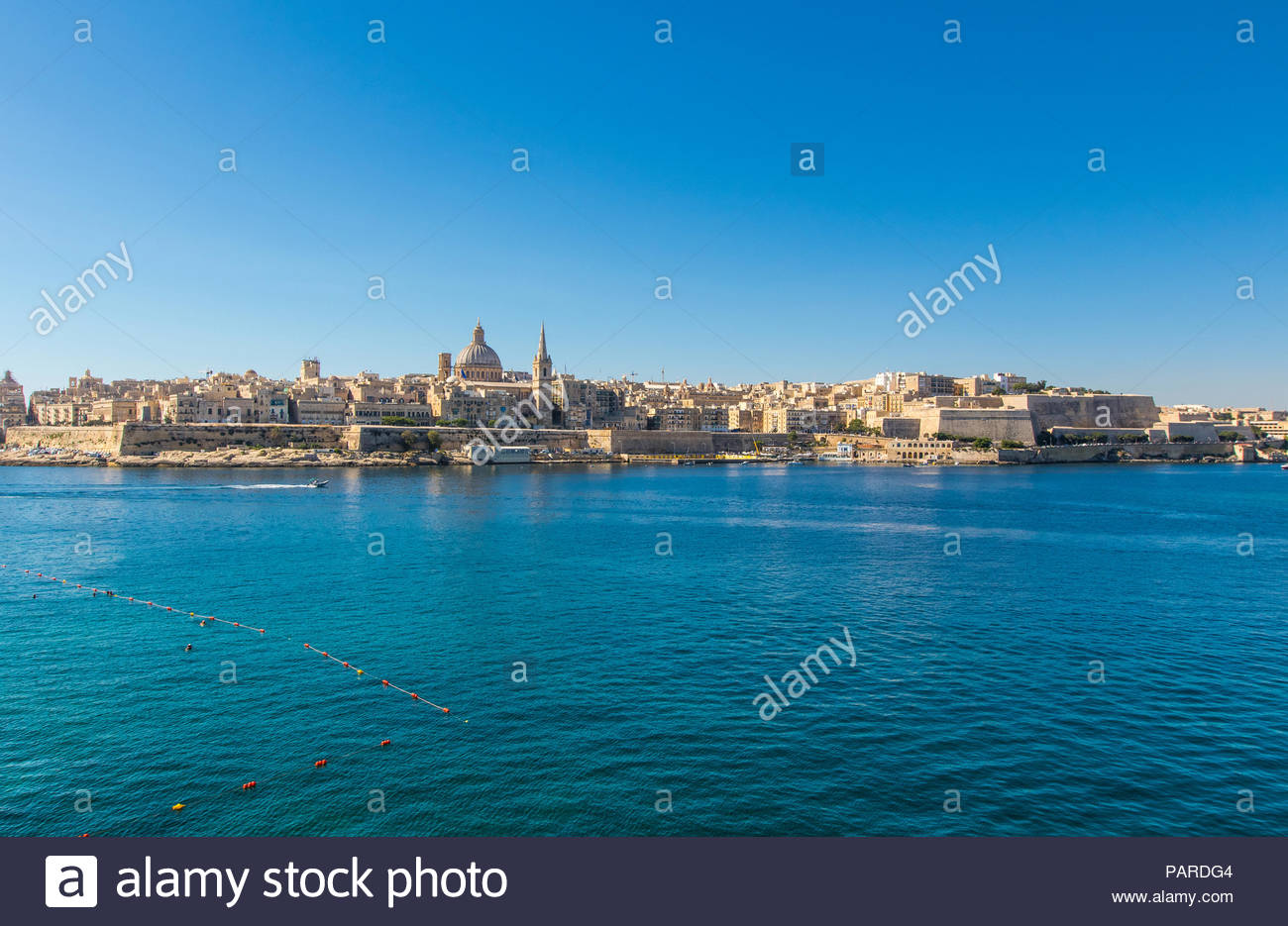 looking from sliema over marsamxett harbour to valletta with the st. paul's pro-cathedral and basilica of our lady of mount carmel, malta Stock Photo