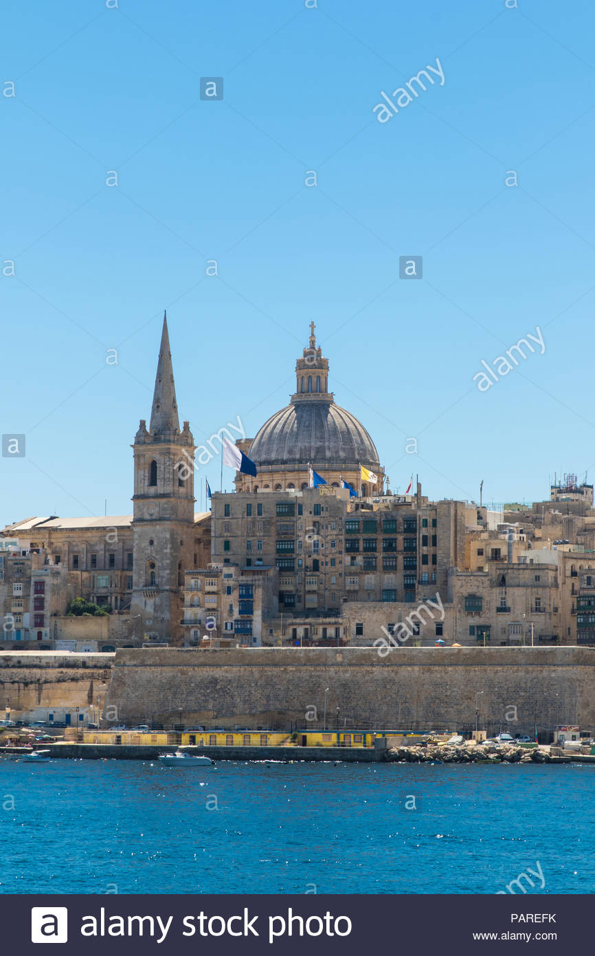 looking from manoel island over marsamxett harbour to valletta with the st. paul's pro-cathedral and basilica of our lady of mount carmel, malta Stock Photo