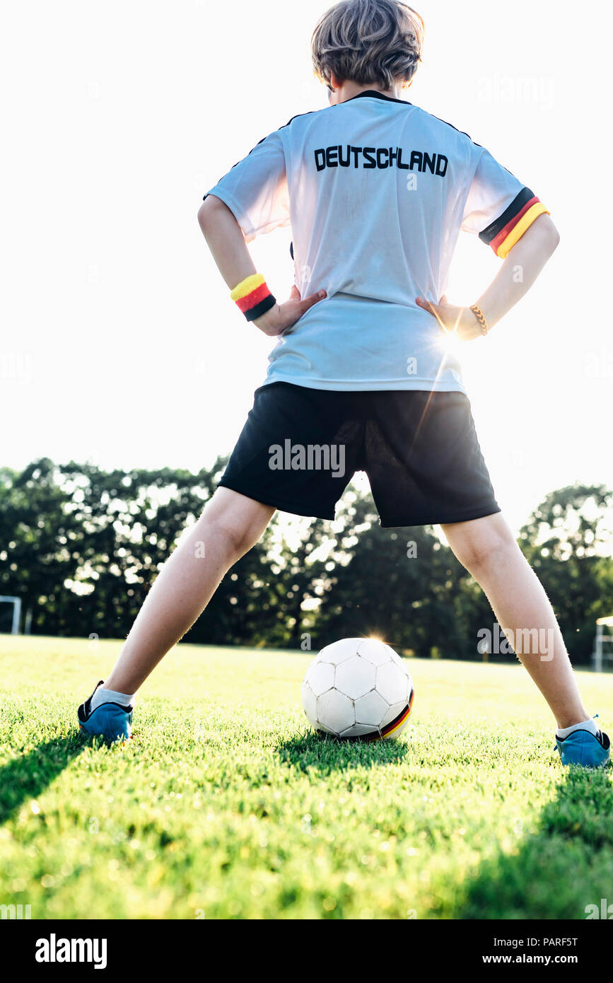 Boy wearing football shirt with Germany written on back - Stock Image
