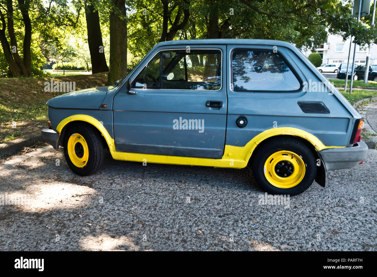 Fiat 126 car in color grey and yellow - Stock Image