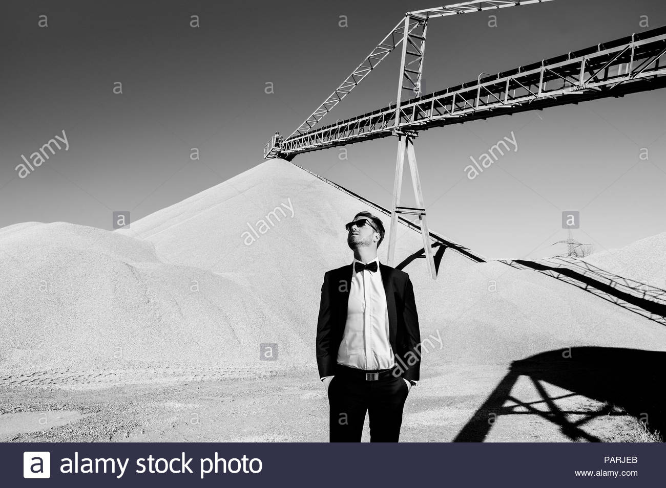 Portrait of young man standing at a construction site - Stock Image