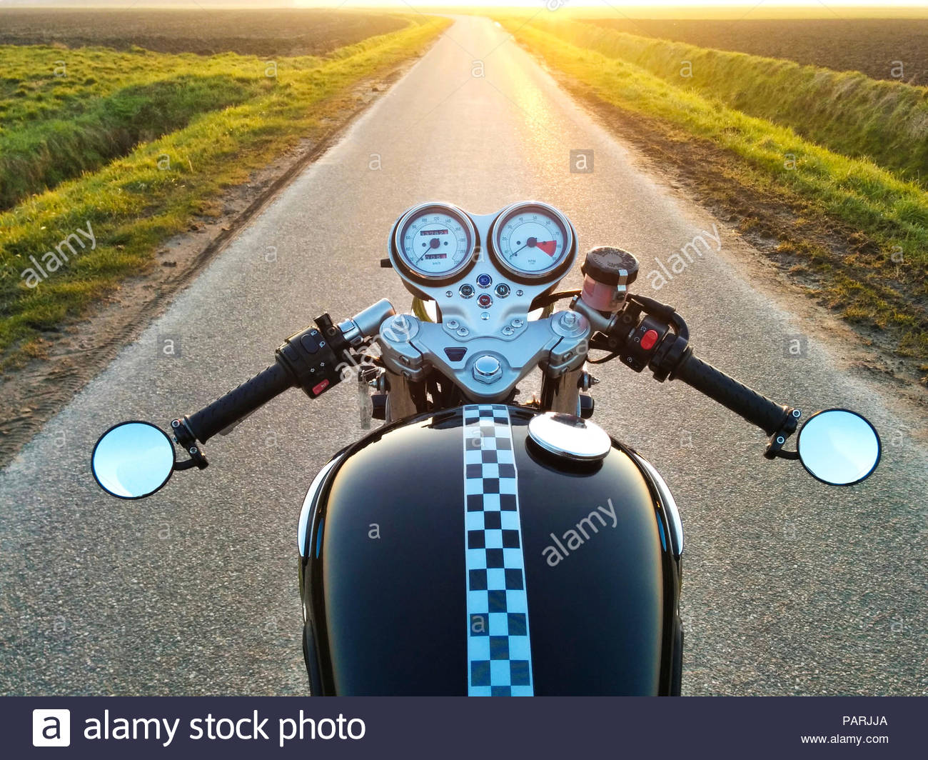 Close-up shot of a bicycle on a road - Stock Image