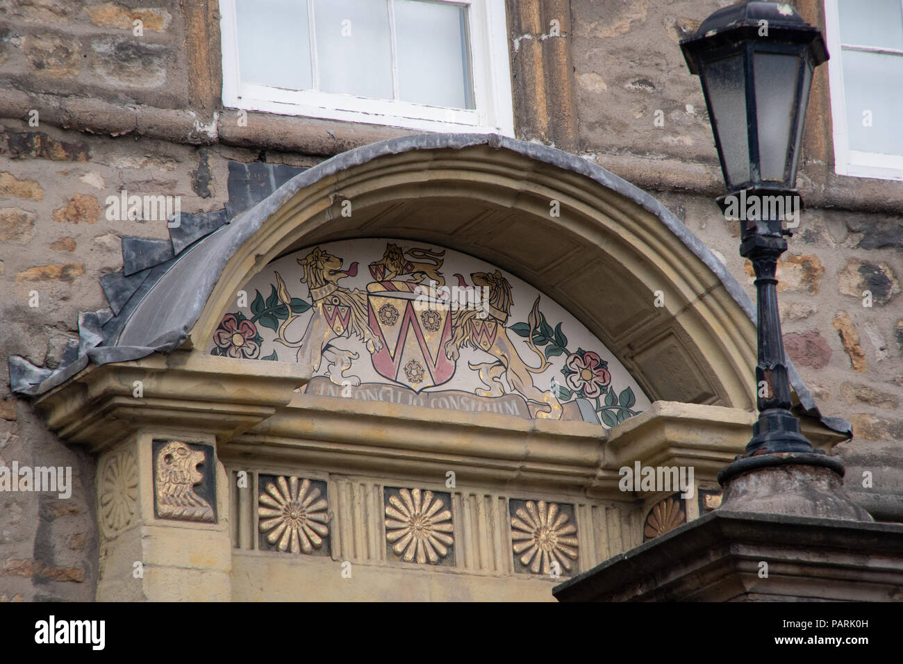 Coat of arms above the door of the building next to the Priory and Judges Lodgings Lancaster city centre around the castle area Stock Photo