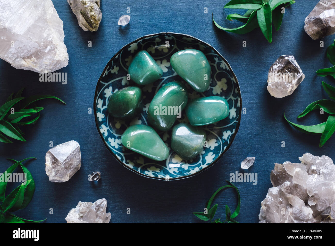 Green Aventurine and Quartz on Blue Table Stock Photo