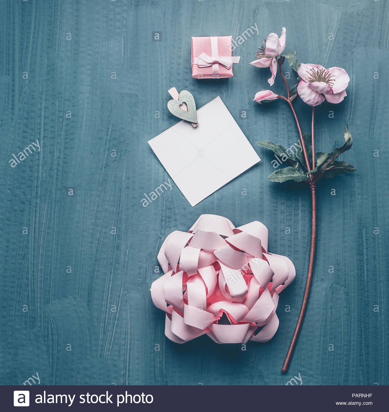 High angle view of pink still life objects on a table - Stock Image