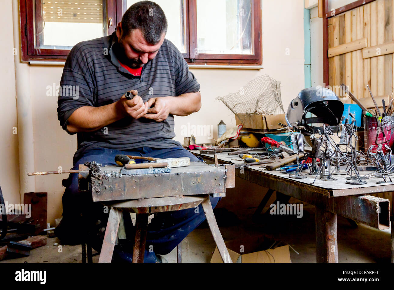 Wire Line Tools Stock Photos Images Alamy Harness Assembly Workbench Artist Is Processing Metal With Special In His Hands To Curve Right Shape