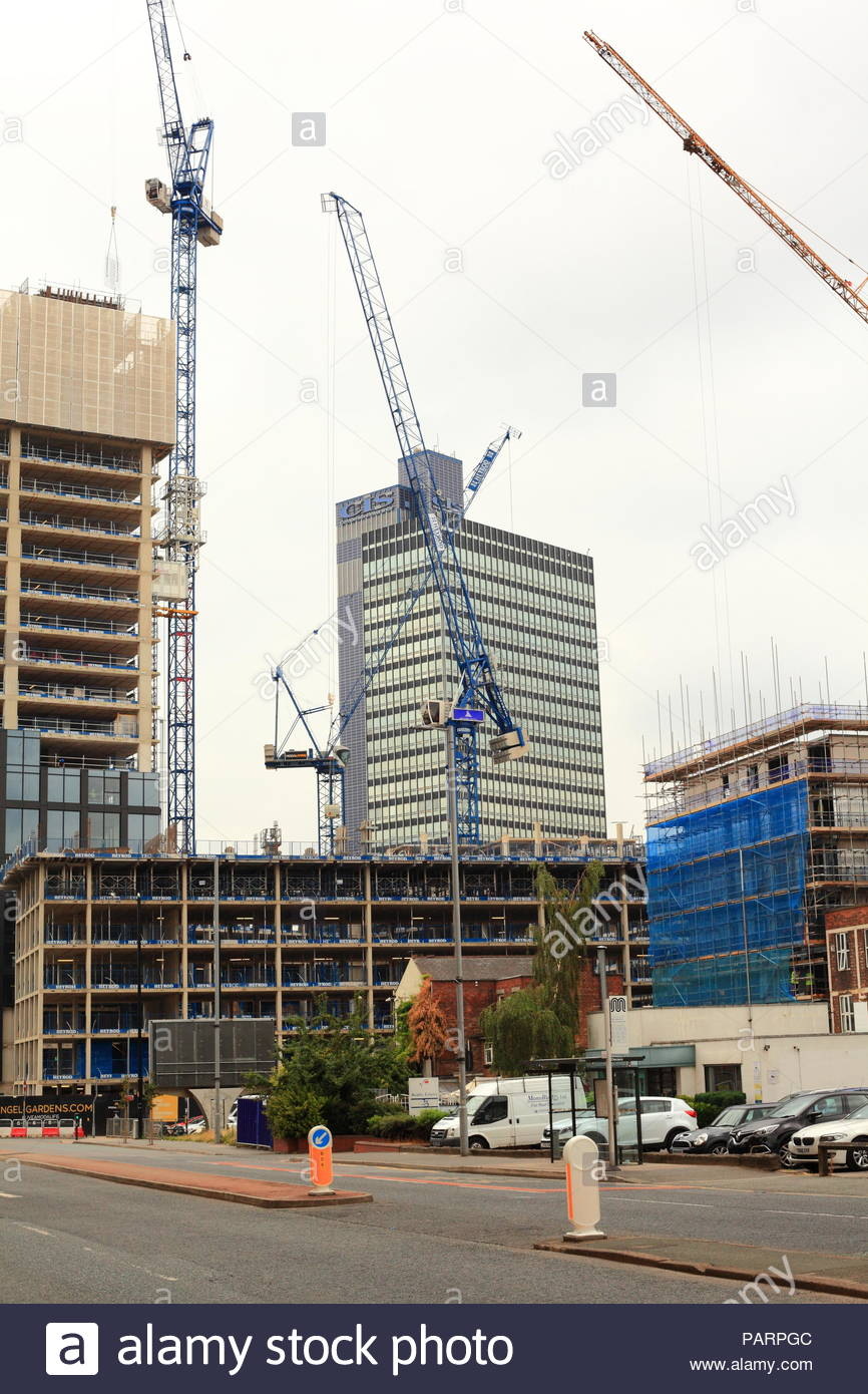 Construction works with cranes surrounding the CIS building in Manchester. Summer July 2018 - Stock Image