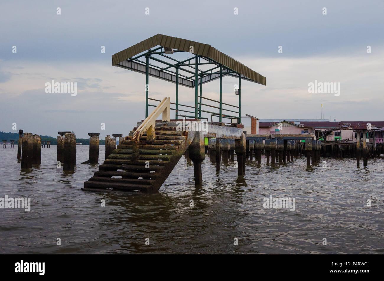 Abandoned pier near a floating village (kampong) in Badar Sri Begawan, Brunei. - Stock Image