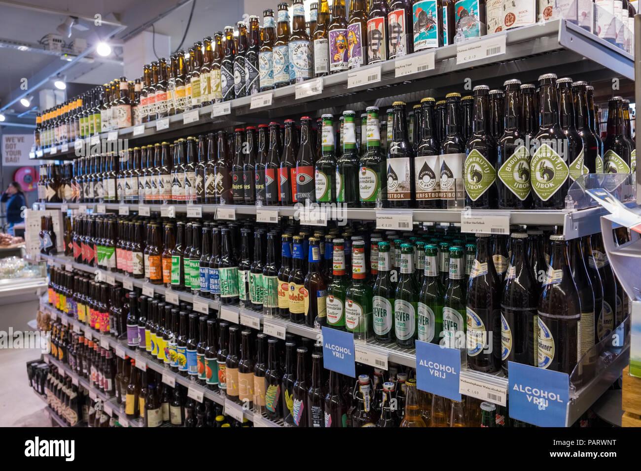 Beer bottles on the shelves of an Amsterdam supermarket, Netherlands, Europe - Stock Image