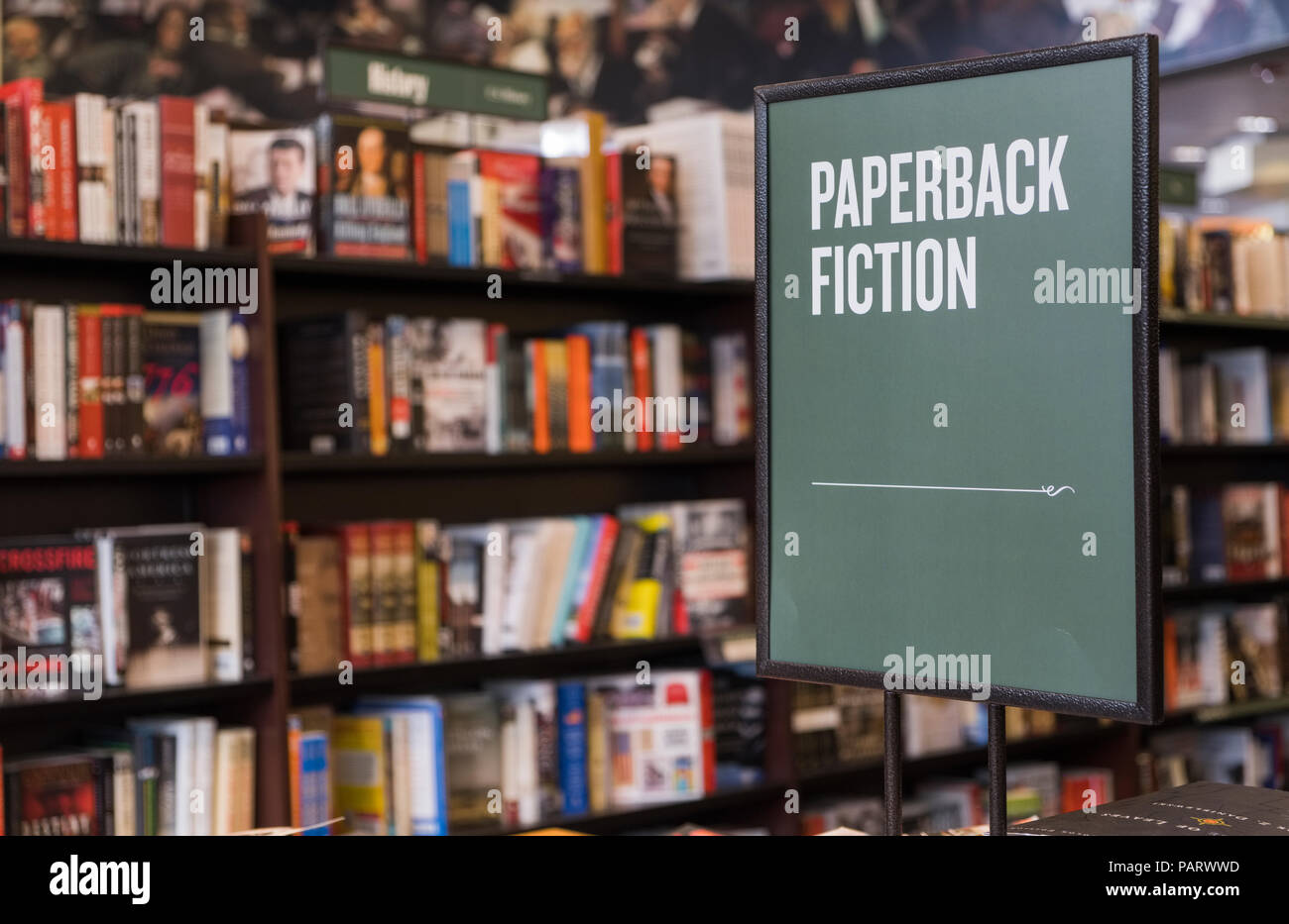 Paperback fiction books sign inside a book shop, UK - Stock Image