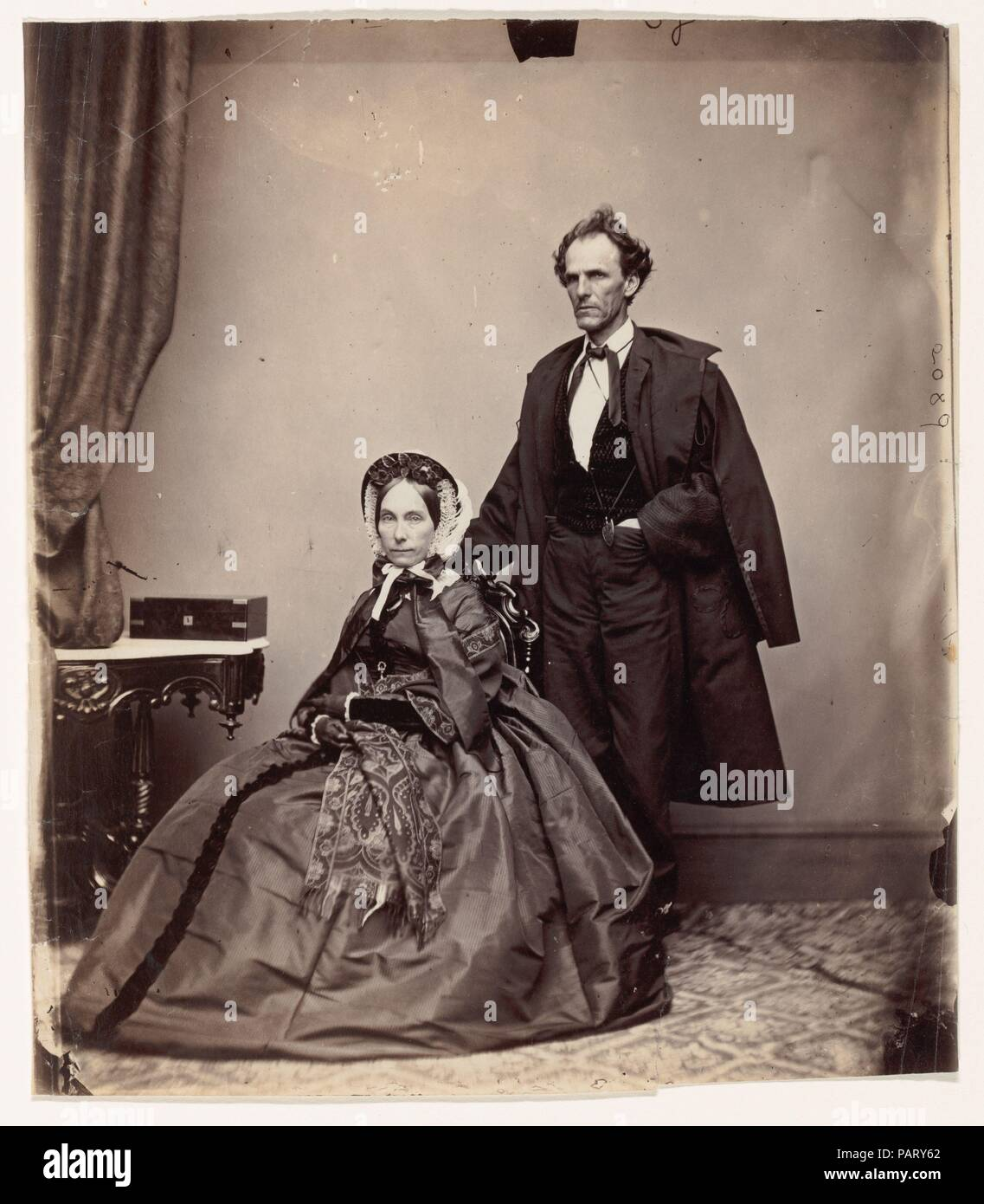 [Senator and Mrs. James Henry Lane]. Dimensions: 22.8 × 19.7 cm (9 × 7 3/4 in.). Photography Studio: Brady & Co. (American, active 1840s-1880s). Date: 1861-66.  Senator James H. Lane of Kansas (1814-1866) was most often seen in a woolen shirt, bearskin overcoat, and straw hat. The fiercest leader of the Free State movement in the 1850s, he brought various antislavery forces together to form a unified party and led military campaigns against pro-slavery towns with such effectiveness and brutality that he earned the sobriquet, the 'Grim Chieftain of Kansas.' Elected as one of the first two senat - Stock Image