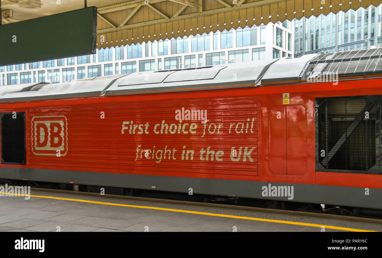 Marketing slogan on the side of a heavy freight locomotive passing through Cardiff Central Station - Stock Image