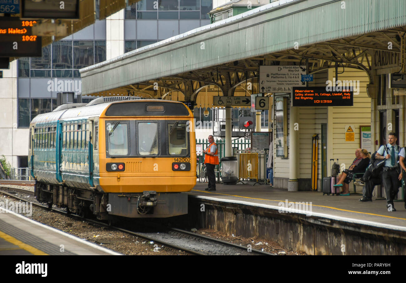 Diesel commuter train alongside a platform at Cardiff Central Station Stock Photo