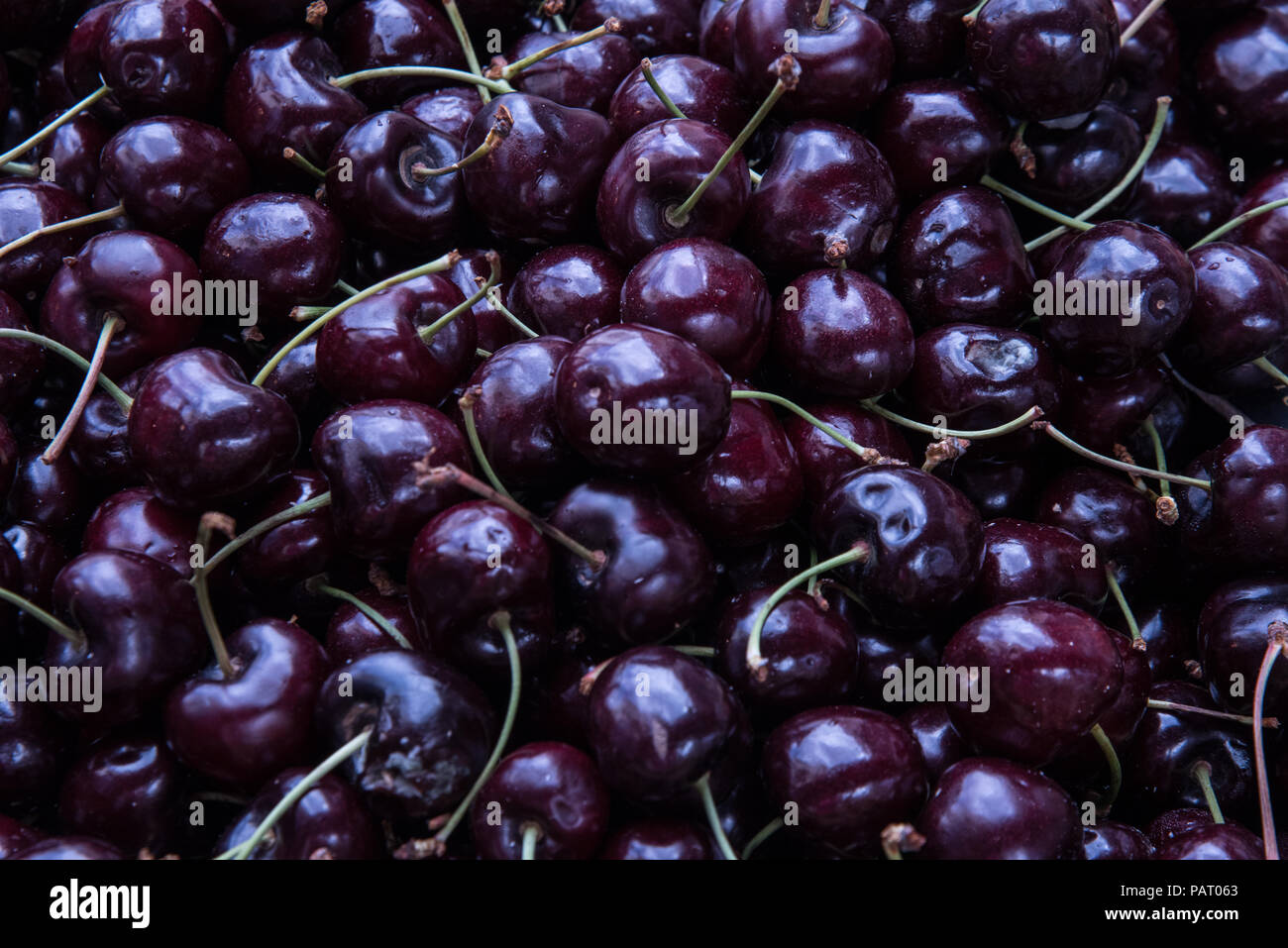 A Large Amount Of Fresh Cherries In Food Market Pile