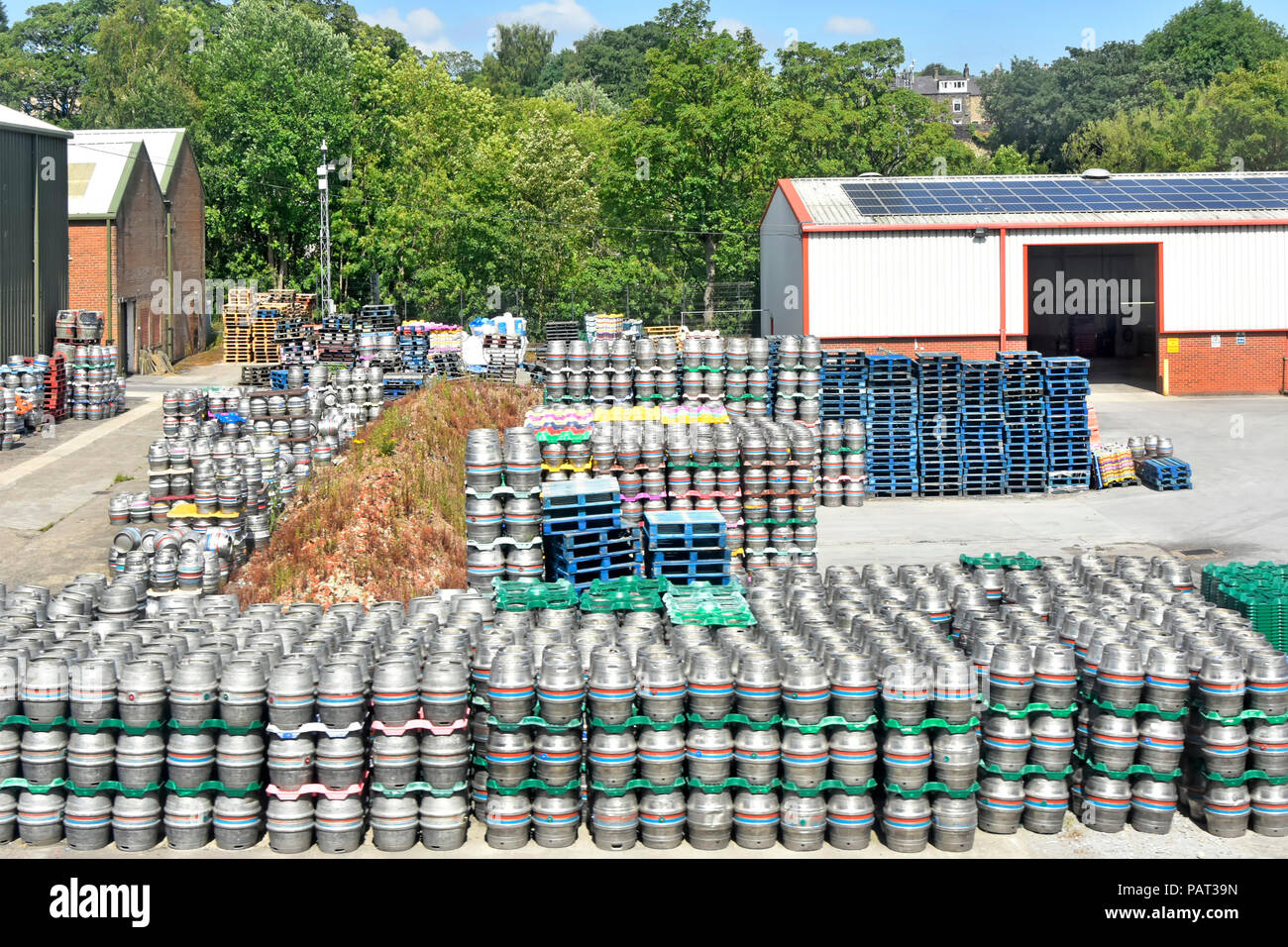 Timothy Taylors Beers small brewery business & yard for beer barrel keg & pallet storage with warehouse buildings Keighley West Yorkshire England UK - Stock Image
