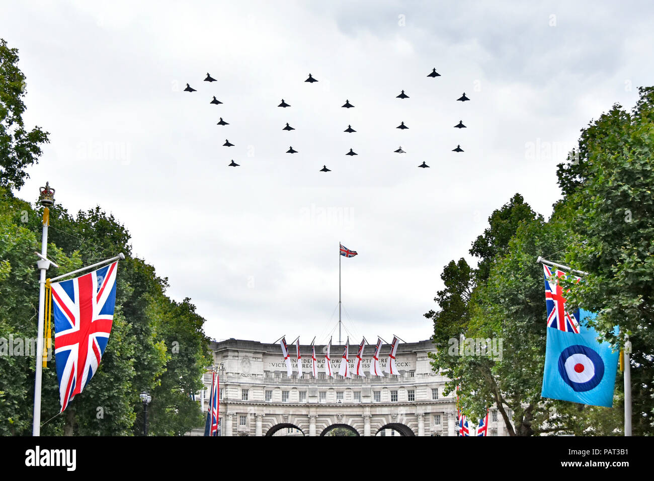 22 Eurofighter Typhoon FGR4 fighter plane RAF ensign centenary flypast over The Mall London flying in 100 figure formation Union Jack flag England UK - Stock Image