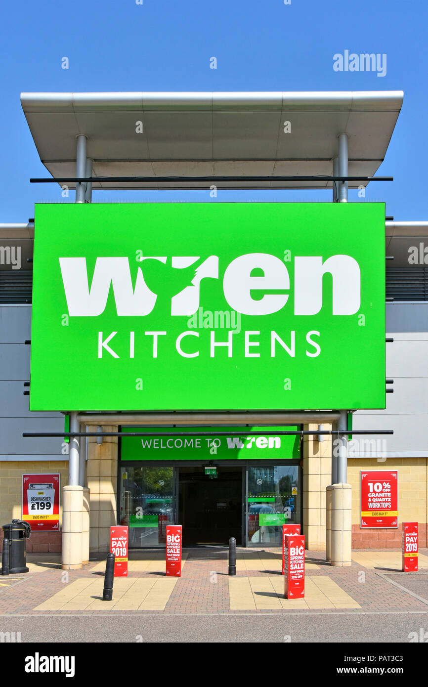 Close up large green store sign for Wren Kitchens retail manufacturing business showroom entrance Lakeside Retail Park West Thurrock Essex England UK - Stock Image