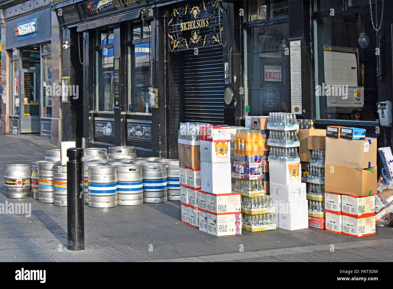 City street scene early morning beer barrels & drink supply chain delivery outside Victoria Comet Nicholsons Pub Newcastle upon Tyne and Wear England - Stock Image
