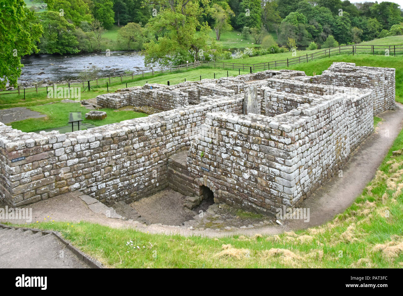 Historical Chesters Roman cavalry fort on Hadrians Wall Roman Bathhouse remains of stone buildings beside River North Tyne Walwick Northumberland UK - Stock Image