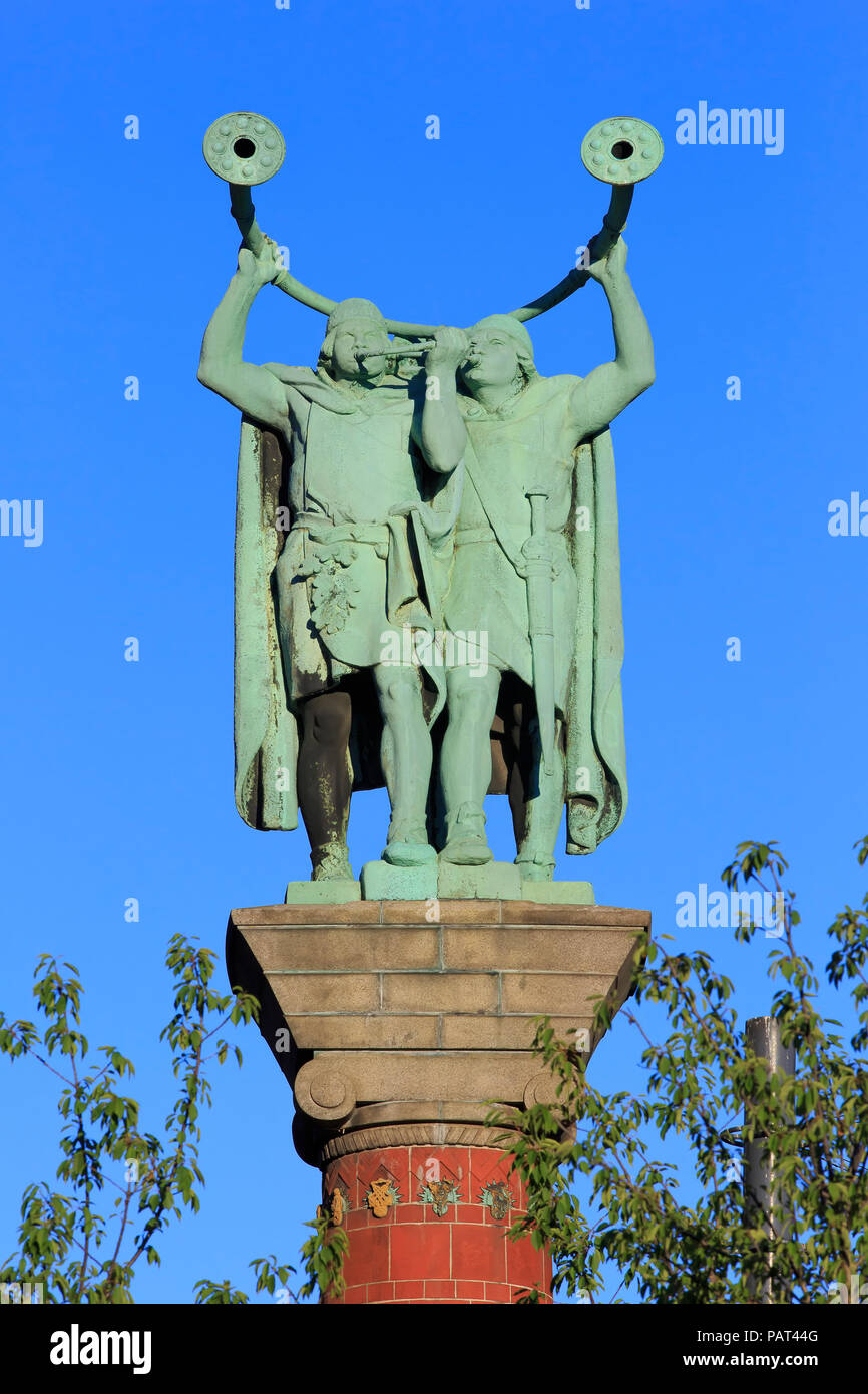 Statue of two Lure Players on top of a column at City Hall Square in Copenhagen, Denmark - Stock Image