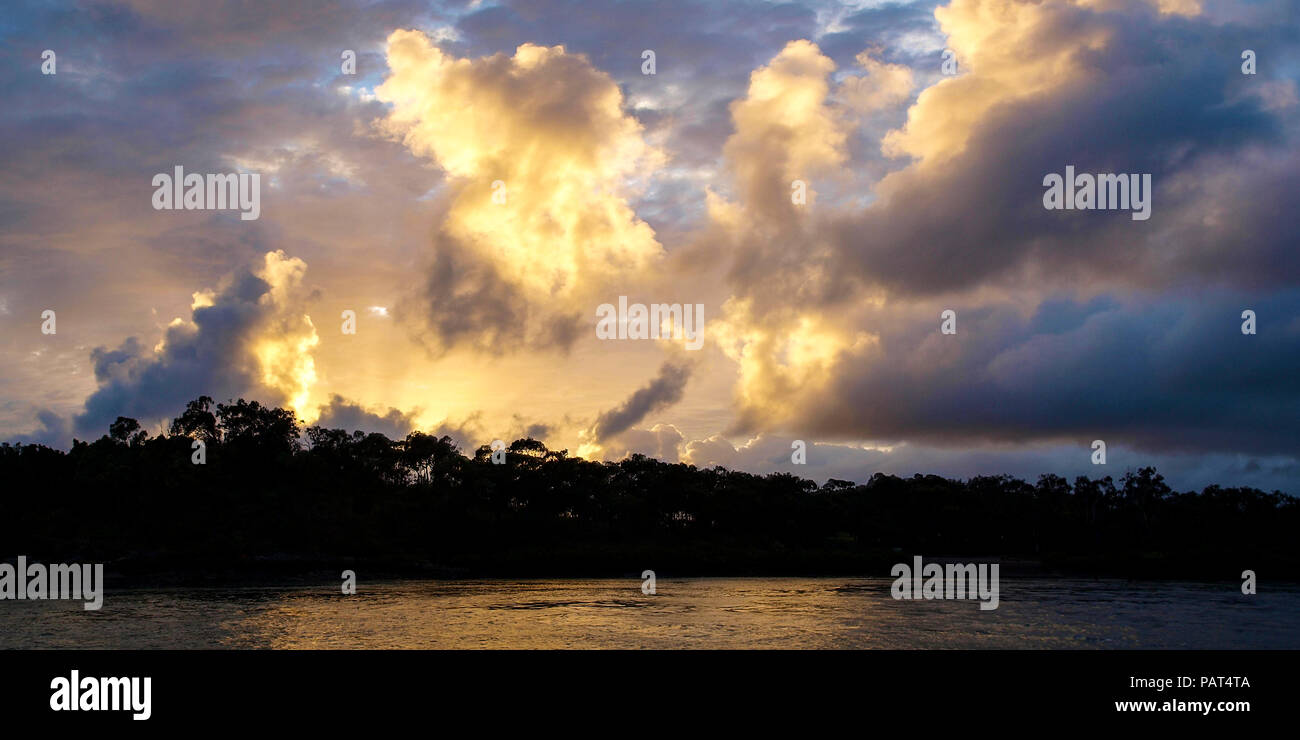 A Vibrant atmospheric cloudy sky cloudscape with white coloured Cumulonimbus cloud formation in a grey sky. Beauty in nature. New South Wales, Austral Stock Photo