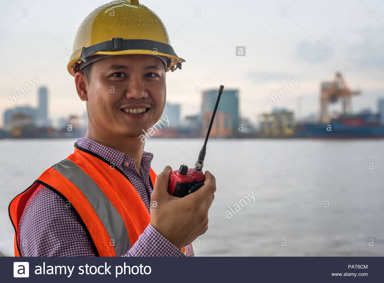Engineer Radio Communication and As-Built Drawing at river side port transportation Stock Photo