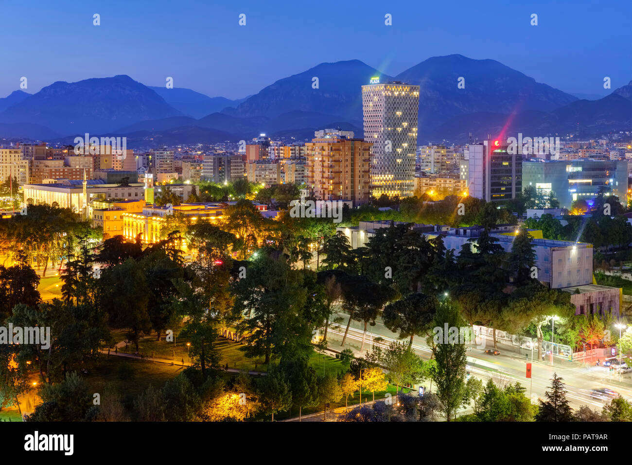 Albania, Tirana, City Center and TID Tower in the evening - Stock Image